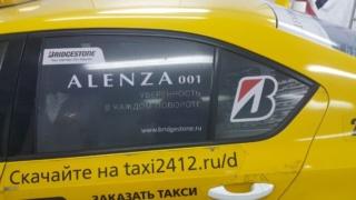 Печать и оклейка такси рекламой «Bridgestone. ALENZA 001»